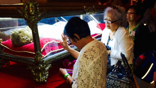 Catholic pilgrims from Detroit visit  the remains of St. Maria Goretti, the youngest canonized saint, while on a trip to Philadelphia to see Pope Francis on Friday, Sept. 25, 2015.