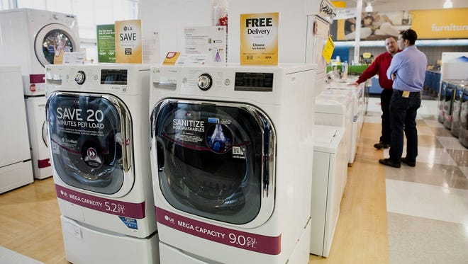 Front-loading, energy-saving washer and dryer sets are for sale at an H.H. Gregg in Reynoldsburg, Ohio.