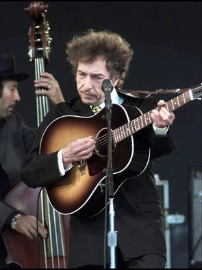 Bob Dylan performing on the main stage at the Roskilde