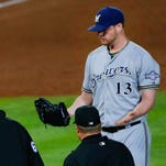 Milwaukee Brewers relief pitcher Will Smith (13) reacts after being ejected from the game against the Atlanta Braves during the seventh inning at Turner Field.