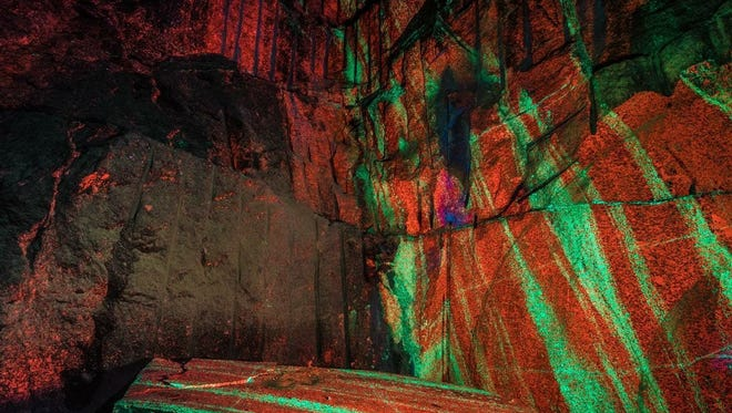 A 19-by-9 foot slab of fluorescent rock was cut from a pit mine in Ogdensburg, N.J.'s Sterling Hill complex in late 2017. The slab is due to be displayed in New York City's American Museum of Natural History in 2019.