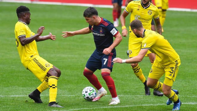Crew defenders harass Fire midfielder Ignacio Aliseda during last Saturday's game. After allowing only two goals in its first 10 regular-season games, the Crew gave up two to Chicago in the first 14 minutes yet rallied to salvage a tie.