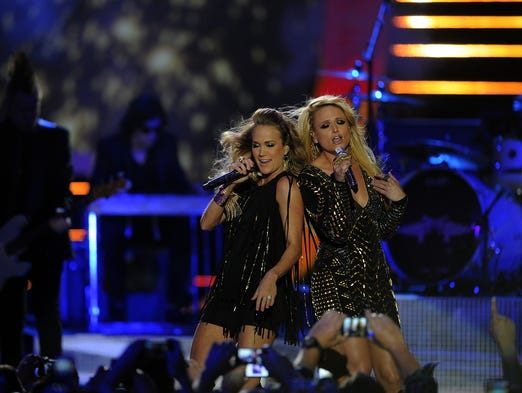 "Carrie Underwood and Miranda Lambert sing ""Something Bad"" at  the CMT Awards show at the Bridgestone Arena in Nashville, Tenn.,  on Wednesday, June 4, 2014."