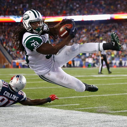 Chris Ivory #33 of the New York Jets is knocked out