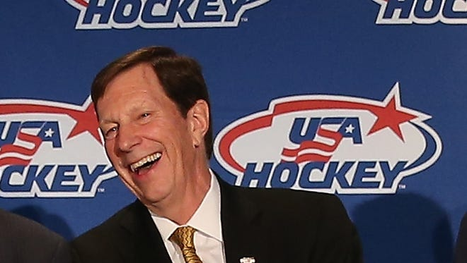(L-R) Ray Shero, the associate general manager and David Poile, the general manager of the 2014 Men's Olympic Hockey Team speak with the media at the Marriott Marquis Hotel.
