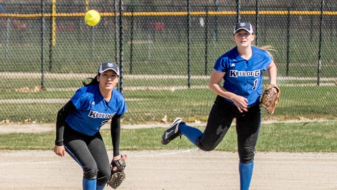 Kellogg Community College freshman Kinslea Blouin (R) throws to second base while Jessica Ramos covers against Lake Michigan College at Bailey Park.