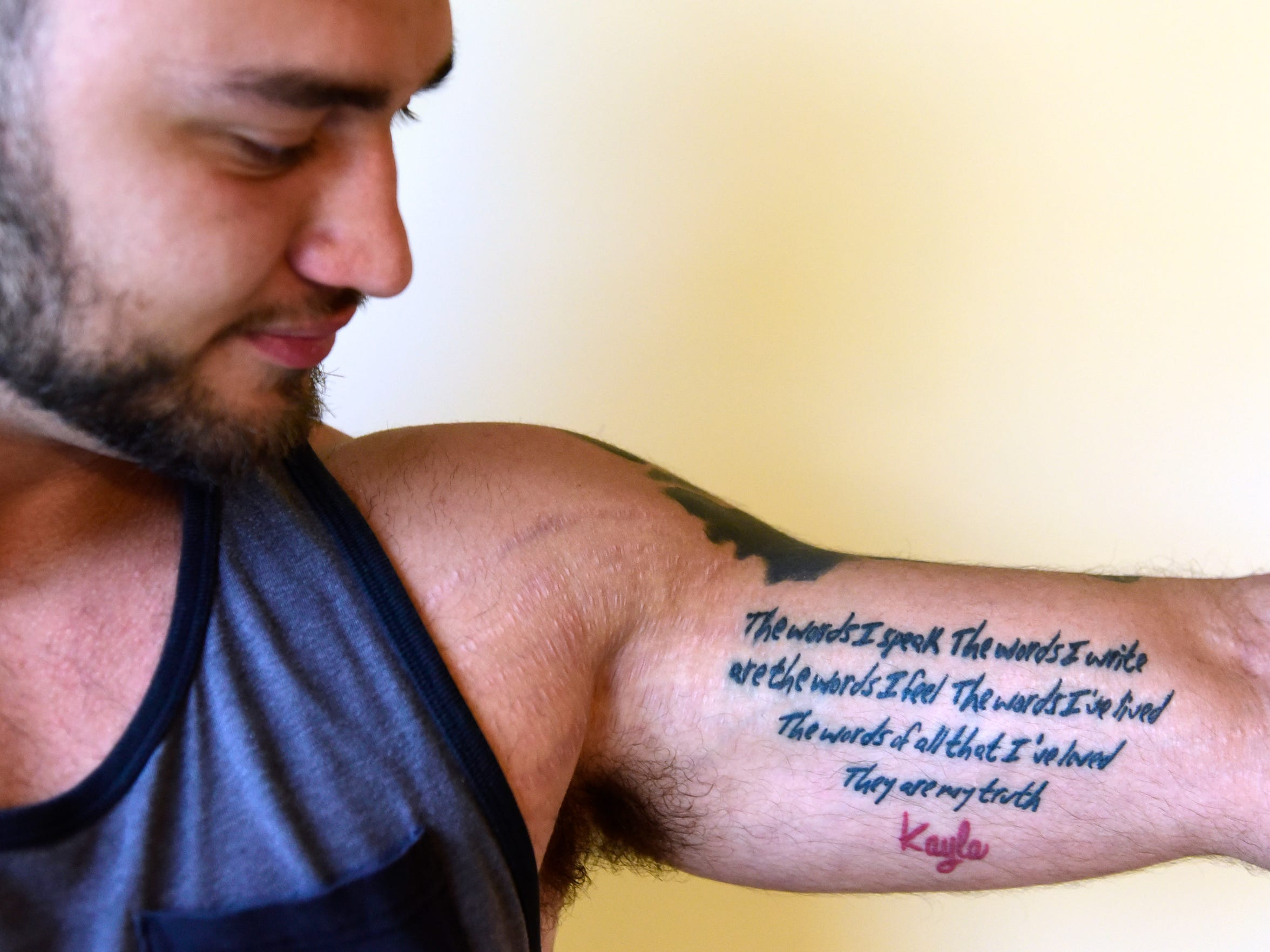 """Richie Webber has Kayla Davis' words tattooed on his arm: """"The words I speak. The words I write are the words I feel. The words I've lived. The words of all that I've loved. They are my truth."""""""