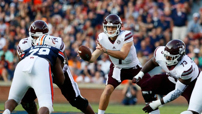 Mississippi State Bulldogs quarterback Nick Fitzgerald (7) takes a snap against the Auburn Tigers
