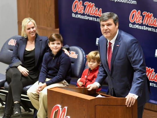 Matt Luke speaks after being introduced as the new NCAA college football head coach at the University of Mississippi during a press conference in Oxford, Miss., Monday, Nov. 27, 2017. At left looking on are Luke's wife Ashley and sons Harrison and Cooper. (Bruce Newman, Oxford Eagle via AP)
