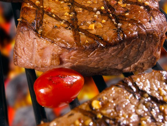 Close-up of steaks cooked over a barbecue grill