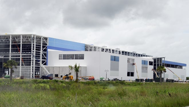 Photo of Blue Origin's New Glenn rocket manufacturing facility rising at Kennedy Space Center's Exploration Park on Merritt Island.
