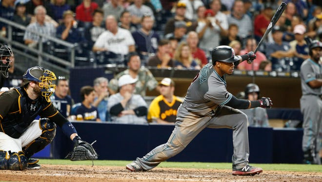 Arizona Diamondbacks' Jean Segura drives a base hit against the San Diego Padres in the eighth inning of a baseball game Friday, Aug. 19, 2016, in San Diego.