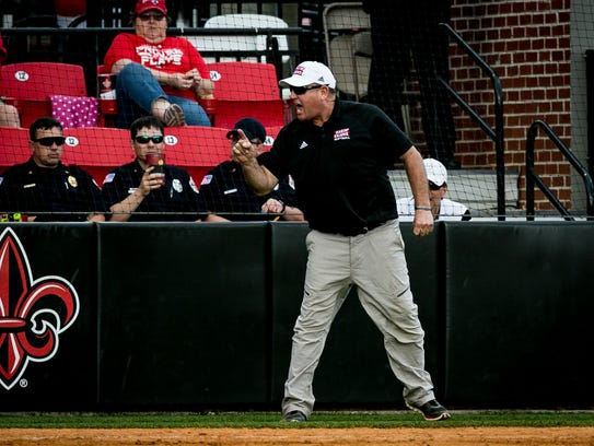 UL softball coach Gerry Glasco argues with the umpire's