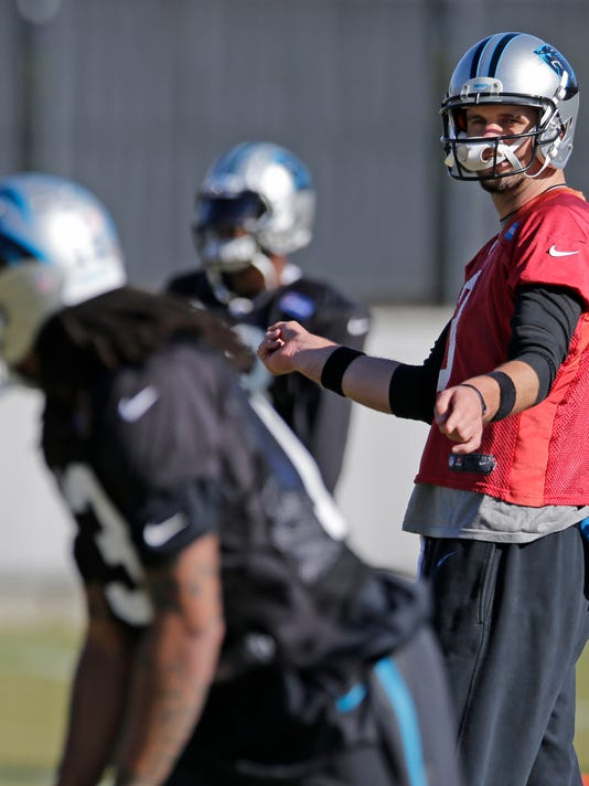 Carolina Panthers quarterback Derek Anderson, right, directs Kelvin Benjamin, left, during an NFL football practice in Charlotte, N.C., Wednesday, Dec. 10, 2014. Anderson will replace starting quarterback Cam Newton on Sunday if Newton is unable to play after being injured in a car crash on Tuesday. (AP Photo/Chuck Burton)