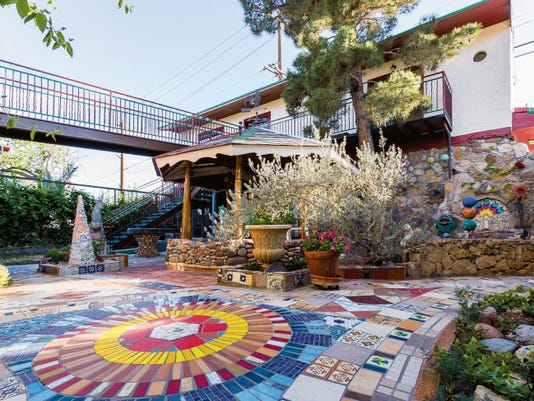 """Walk the new bridge over his """"magic courtyard"""" to Hal Marcus' garage studio behind his house in Sunset Heights. The studio will be open to the public from noon to 5 p.m. today."""