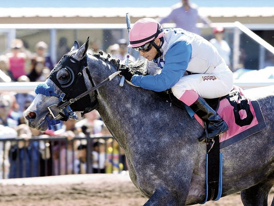 Courtesy Photo - Coady Photography. Unfettered, shown here winning the Bill Thomas Memorial Handicap at Sunland Park in El Paso, Texas on March 22, 2015, is the 3-to-1 morning-line favorite in the 35,000 Inaugural Handicap, the featured race on today's opening day program at Sunray Park and Casino.
