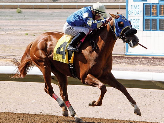 Courtesy Photo - Coady Photography. Alsono, shown here winning the Sunray Park and Casino Handicap on May 3, 2014, is  the morning-line favorite in Sunday's Marathon Handicap.