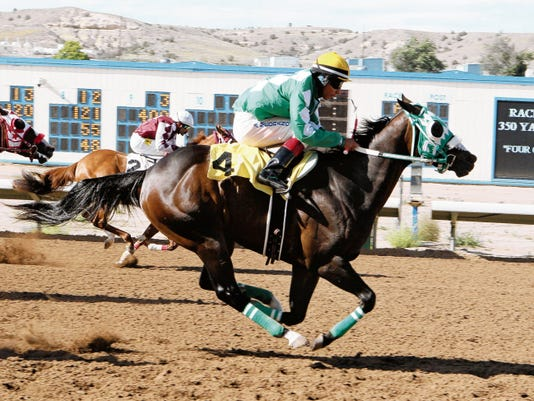 Good Job Honey (4), ridden by Albert Medrano for trainer Ken Grisham, crosses the wire just ahead of Pilota On Fire (2) in the fourth and fastest qualifying trial for the Aug. 9 Four Corners Futurity at Sunray Park and Casino.