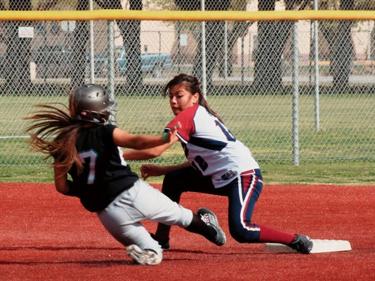 Bill Armendariz - Headlight Photo   Senior short stop Aileen Granillo sweeps a tag on Onate's Brandi Hernandez during Tuesday's opening game of a District 3-6A double header. The Knights swept the Deming High girls 9-3 and 10-1 at Hooten Park.