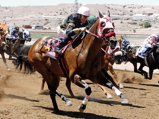 Courtesy Photo - Coady Photography. Miracle Snow, shown here winning the Jimmy Drake Stakes at Sunray Park and Casino on June 1, 2014 with jockey Martin Bourdieu, has been retired from racing after winning 17 times from 62 starts in a career that spanned nine years.