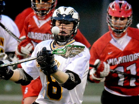 Red Lion's Nick Shima gains possession with Susquehannock's Tucker Devilbiss (11) in pursuit during lacrosse action at Red Lion on Thursday. Red Lion handed Susquehannock its first York-Adams League loss of the season, 17-8.