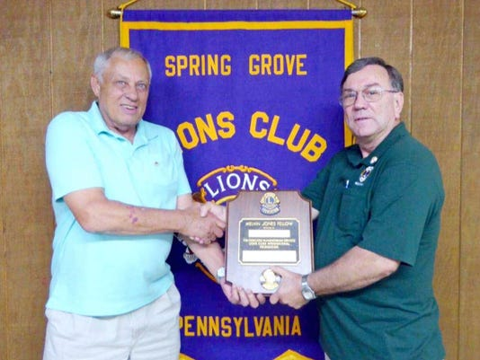 Spring Grove Lions President Sam Sterner, right, presents the Melvin Jones Fellowship Award to Dennis Wagner for his years of service to the club. The award includes a 1000 donation to the Lions Club International Foundation to support the foundation's humanitarian efforts throughout the world.