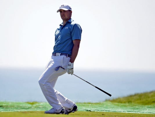 Jordan Spieth reacts to a shot on the 12th hole during a practice round for the PGA Championship golf tournament Tuesday at Whistling Straits in Haven, Wis.