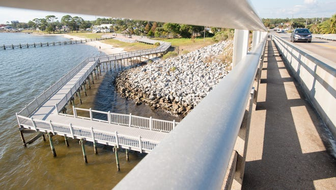 Due to disrepair and safety concerns, the boardwalk that goes under the bridge at Navarre Park remains closed in Navarre on Monday, November 6, 2017.