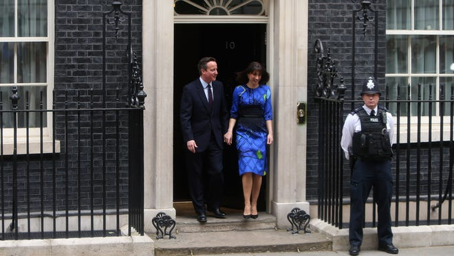 British Prime Minister David Cameron and his wife Samantha Cameron leave Downing Street on May 8, 2015, in London, England.