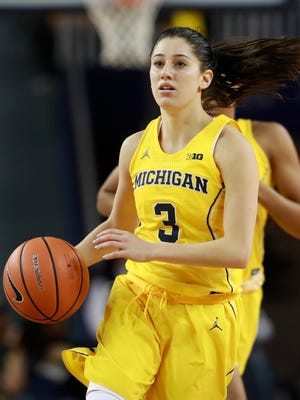 Katelynn Flaherty and Michigan move up to No. 16 in the this week's AP rankings.