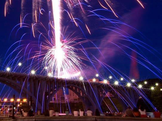 Onlookers watch fireworks over the Henley Street Bridge