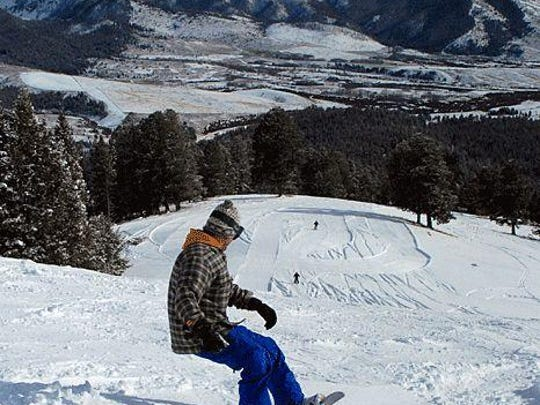 A snowboarder rides Maverick Mountain near Dillon.