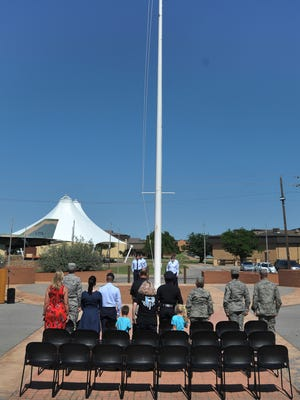 A small crowd saluted and honored the American flag Thursday afternoon during a ceremony at Sheppard Air Force Base held to remember both military and civilian peace officers.
