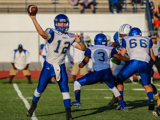 Martin County's Austin Kuyrkendall (center) looks to