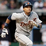 Detroit Tigers' Dixon Machado grounds in to a fielders choice in the fifth inning of the second game of a baseball doubleheader against the Cleveland Indians, Sunday, Sept. 13, 2015, in Cleveland. Victor Martinez scored on the play.