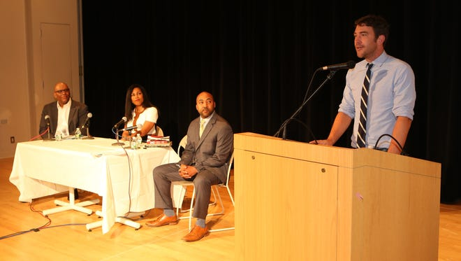 "Author Jeff Hobbs delivers remarks as Reginald Richardson, author Ilyasah Shabazz and Jared Rice listen during the New Rochelle My Brother's Keeper, ""New Rochelle: All on the Same Page"" reading program at New Rochelle Public Library, May 13, 2017."