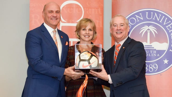 Clemson President James P. Clements thanks Gretchen and Joe Erwin for their academic cornerstone gift at Thursday's announcement.