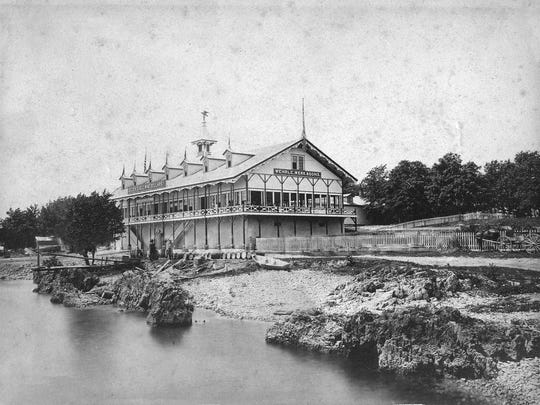 """The """"Golden Eagle Winery"""" on Middle Bass Island, owned by German stone-cutter Andrew Wehrle, was one of the most popular wineries in the world by 1875. This 1880s photograph shows the large wooden winery and dance hall, which burned to the ground in 1923."""