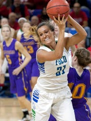FGCU's Jamie Gluesing grabs a rebound against Lipscomb defenders Saturday (2/14/15) at Alico Arena in Fort Myers.