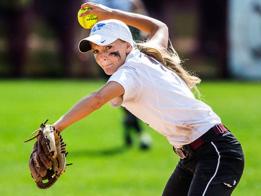 Caravel short stop Samantha Esper throws out a runner at first during Caravel's 10-0 win over Charter in their semi-final game of the DIAA State Softball tournament at Caravel Academy on Thursday afternoon.