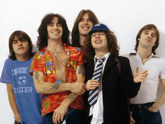 From left to right AC/DC members Malcolm Young, Bon