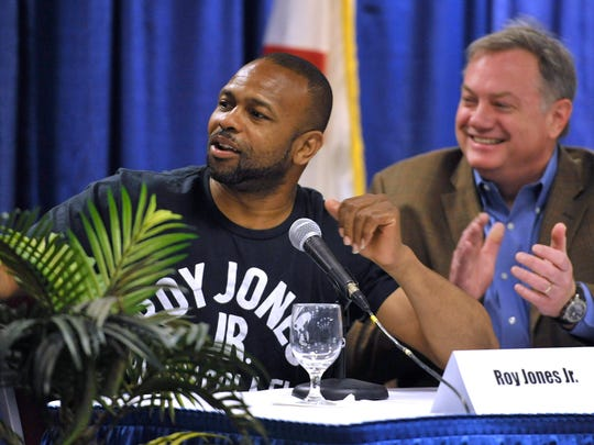 Boxing legend Roy Jones, Jr. left, and Square Ring fight promoter John Wirt, talk Island Fights events CEO, Dean Toole (off camera left), who was reluctant to speak in front of the public, into finishing what he started to say about some of the upcoming Island Fights 33 matches and fighters.  Toole was, reluctantly, speaking at a press conference for the event Wednesday afternoon at the Pensacola Bay Center where the MMA and boxing matches will be held Saturday night.