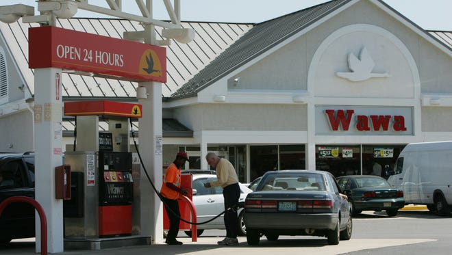Drivers fill their gas tanks at Wawa on Route 34 in Wall.