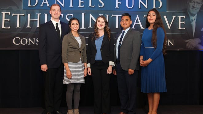 Members of New Mexico State University's Daniels Fund Ethics Initiative team are, from left, Adam Tirado, Renee Baca, Esme Brown, Salvador Flores and Deyanira Flores. The team was among 10 teams from universities in Colorado, New Mexico, Utah and Wyoming to compete in the sixth annual Consortium Case Competition in Denver on April 27-28.  Following their impressive presentation a couple of the students have expressed their desire to go back and compete again next year.