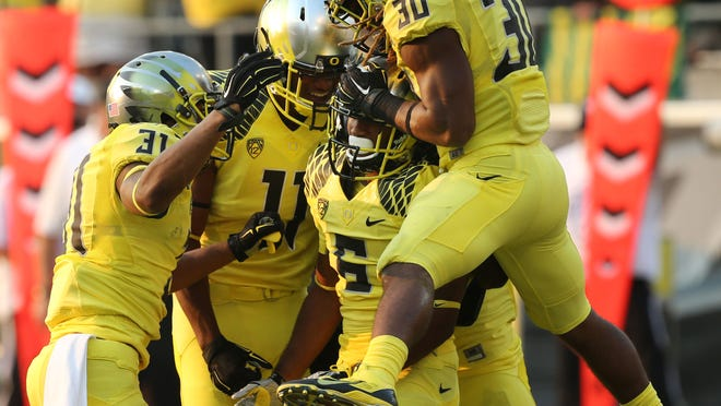 Members of the Oregon special teams including Kenny Bassett, left, Bralon Addison, Dominique Harrison and Ayele Forde celebrate after stopping a Michigan State kickoff run return in the third quarter Saturday.