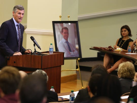 Michael Cahill, Vice Dean and Professor of Law at Brooklyn Law School speaks about his friend as a memorial for slain FSU professor Dan Markel was held in Roberts Hall at the FSU College of Law on Tuesday afternoon.