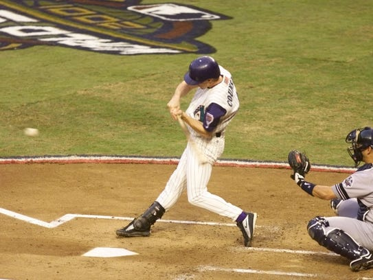 Craig Counsell hits a home run in Game 1.