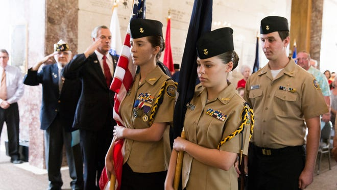 Members of the Comeaux High Navy JROTC present the colors during a Memorial Day Service at Lafayette Memorial Park Cemetery May 30, 2016.