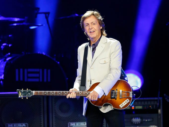 Paul McCartney performs during his 'Out There' world tour Tuesday, Aug. 12,  2014 at US Airways Center in Phoenix, Arizona.