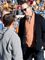 Former Tennessee and NFL great Peyton Manning chats on the sidelines before the start of the Franklin American Mortgage Music City Bowl at Nissan Stadium in Nashville on Dec. 30, 2016. Tennessee beat Nebraska 38-24.